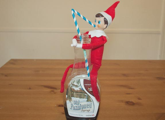 Elf-on-the-shelf-ideas-Elf-drinking-the-syrup.jpg